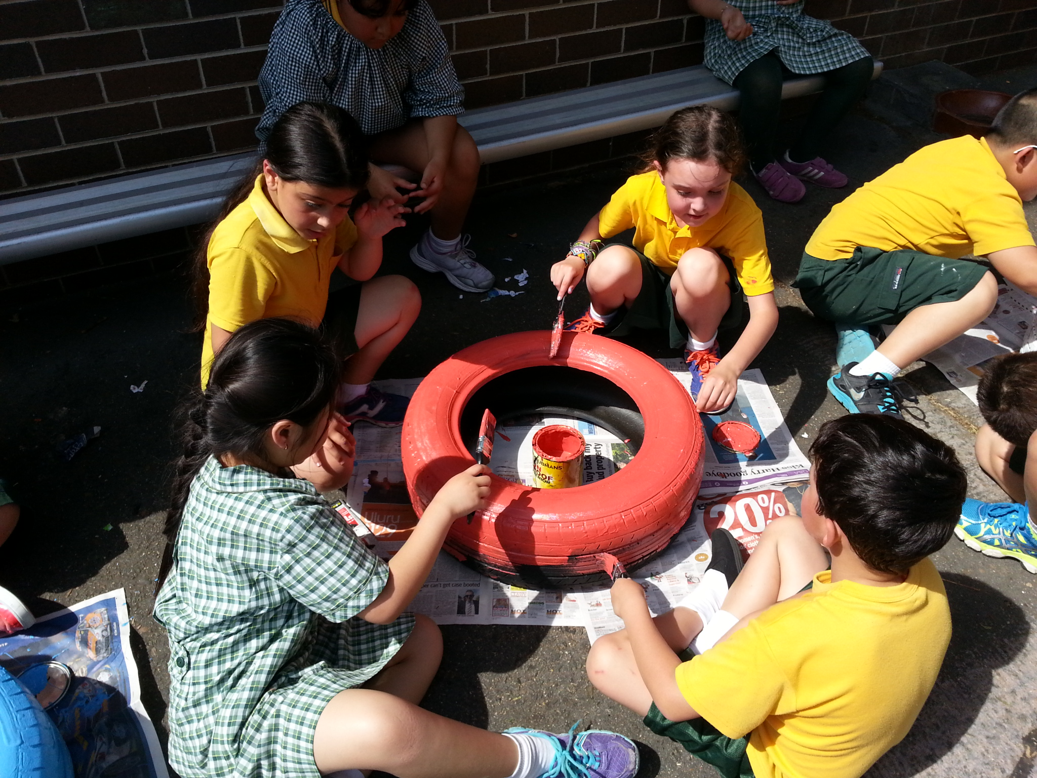 Students painting tyres